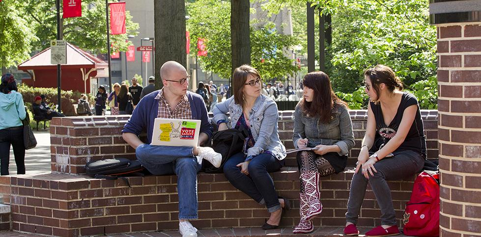 Students sitting on park bench