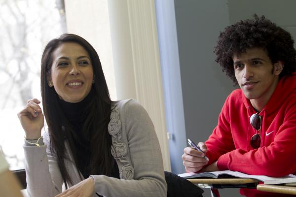Smiling girl and a guy sitting in a classroom